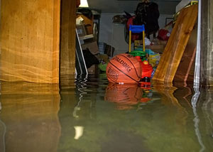 A flooded basement bedroom in Little Falls