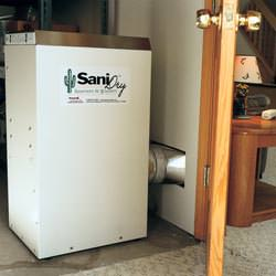 A basement dehumidifier with an ENERGY STAR® rating ducting dry air into a finished area of the basement  in Clay