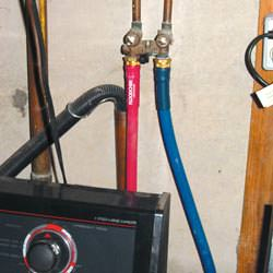 Washer hoses in a basement  in Jamesville