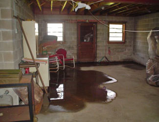 a flooded basement floor in a Clay home