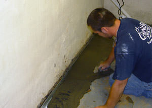 Restoring a concrete slab floor with fresh concrete after jackhammering it and installing a drain system in Union.